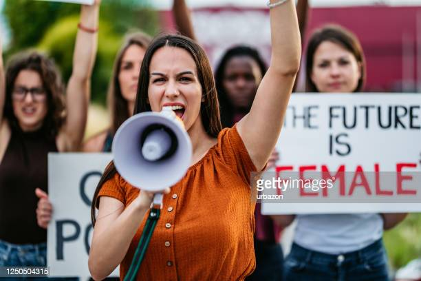 women protesting for equality and women rights - marching stock pictures, royalty-free photos & images