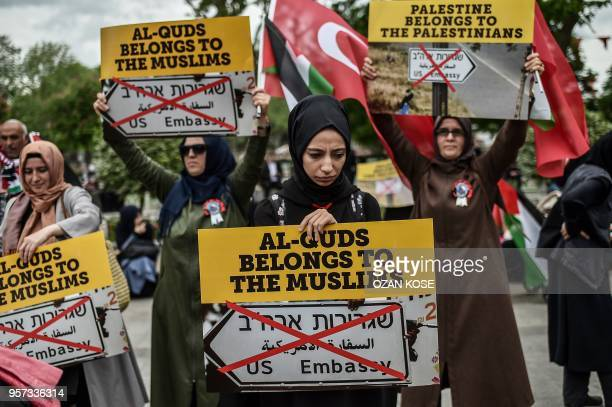 TOPSHOT Women protestors hold placards reading 'Al Quds belongs to muslims' on May 11 2018 in Istanbul during a demonstration against US President...