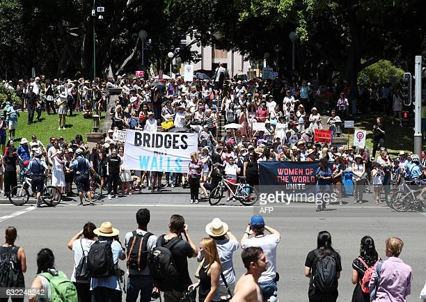 Women protestors march in a rally against US President Donald Trump following his inauguration in Sydney on January 21 2017 A Women's March kicked...