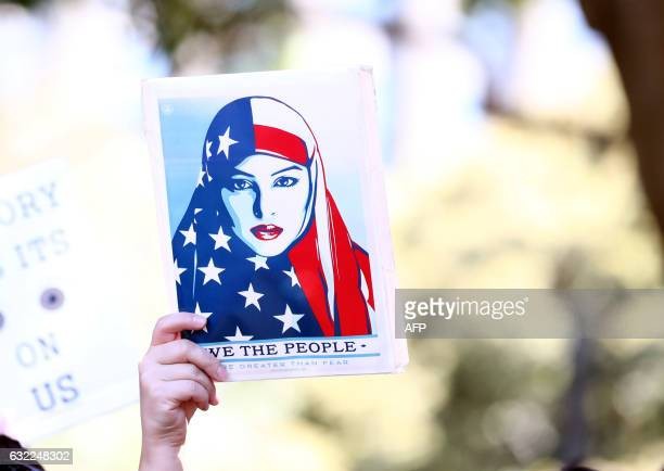 TOPSHOT Women protestors march in a rally against US President Donald Trump following his inauguration in Sydney on January 21 2017 A Women's March...