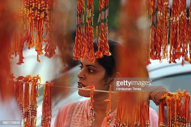 Women purchasing rakhis at sector14 Huda Market ahead of Raksha Bandhan on August 16 2016 in Gurgaon India Raksha Bandhan or Rakhi celebrate the...