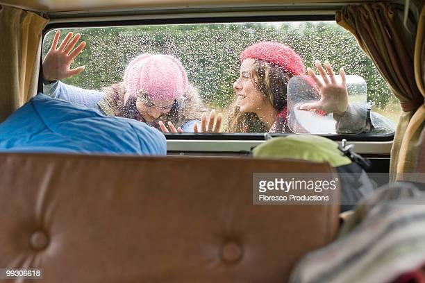 Women pushing camper van