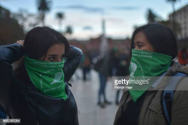 Women put on thegreen handkerchiefs that symbolize the abortion rights struggle during a protest as part of the 'Not One Less' movement demanding...