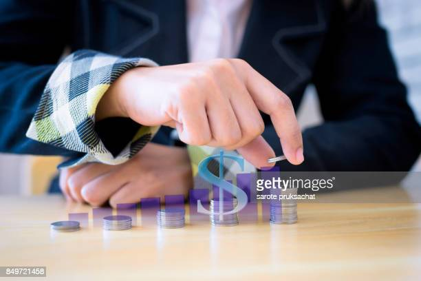 Women putting coins on stack with holding money, Concept business, finance, money saving