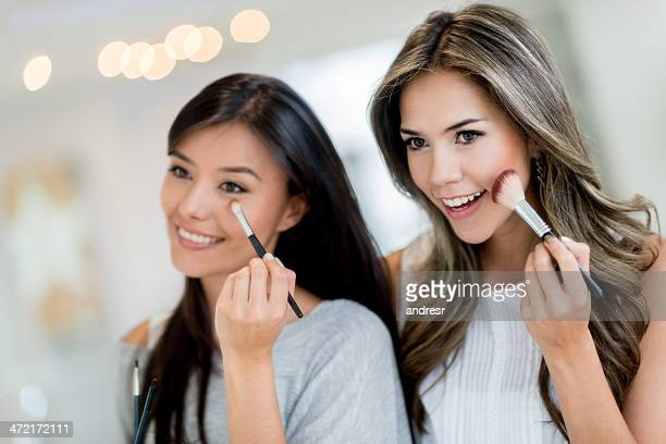 Women putting make up on