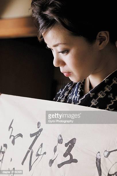 Women putting on a kimono, close up