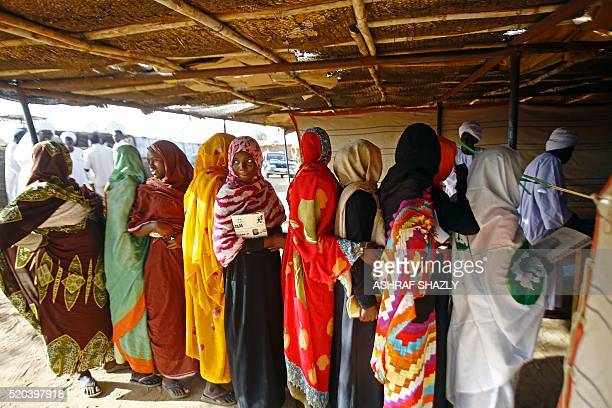 Women queue at a polling station at the Abu Shouq camp for Internally Displaced Persons in ElFasher in North Darfur on April 11 during a referendum...