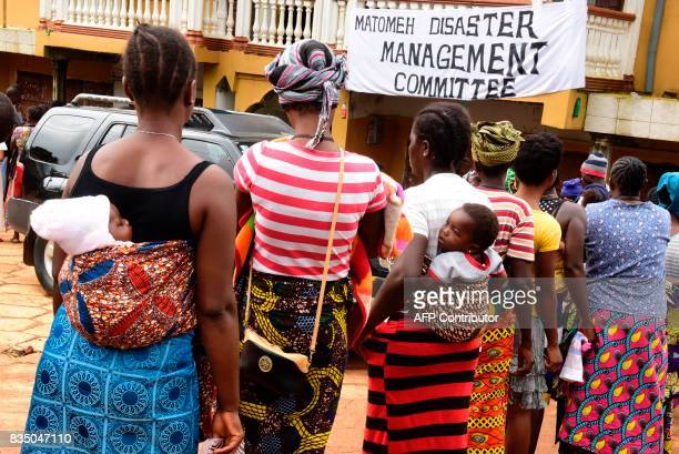 Women queue for disaster relief assistance on August 18 2017 in Freetown following heavy rains and mudslides resulting in more than 400 deaths More...