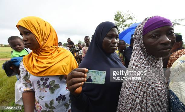TOPSHOT Women queue to cast their vote during the Osun State gubernatorial election in Ede in the Osun State in southwest Nigeria on September 22...