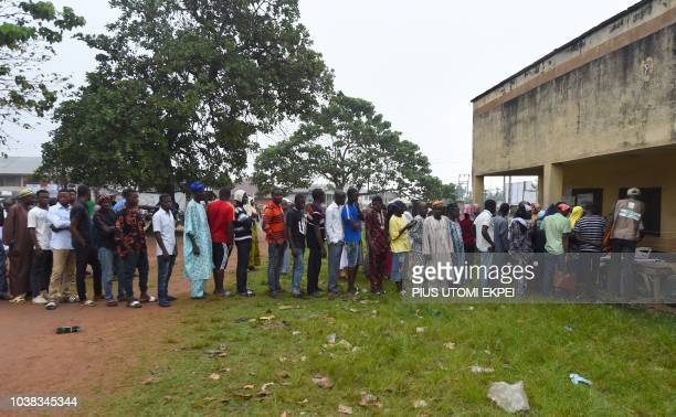 Women queue to cast their vote during the Osun State gubernatorial election in Ede in the Osun State in southwest Nigeria on September 22 2018 The...
