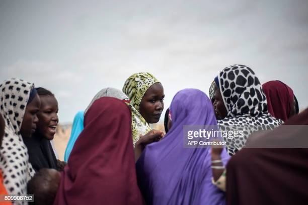 Women queue to receive medical treatment at the Bakassi Internally Displaced Peoples Camp on July 6 2017 in Maiduguri The Nigerian Military held the...