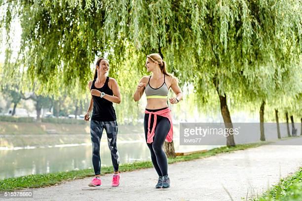 Women quickly walking in park
