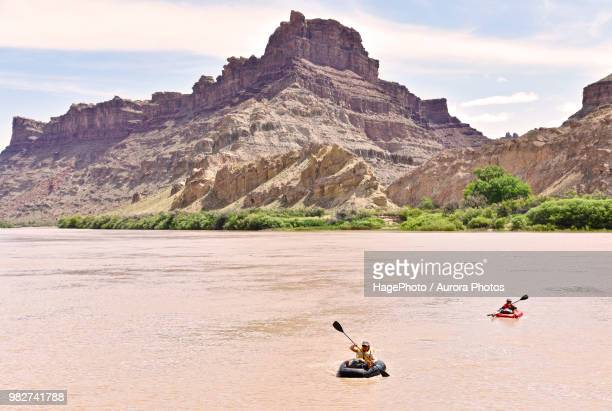women rafting in river in canyonlands national park, moab, utah, usa - canyonlands national park stock pictures, royalty-free photos & images