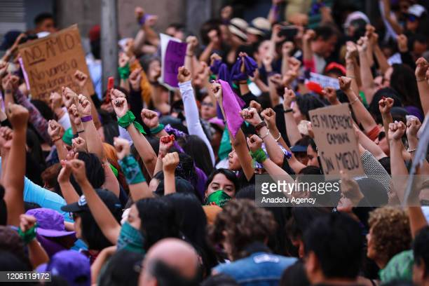 Women raise their fists during a protest on the International Women's Day in Mexico City Mexico on March 8 2020