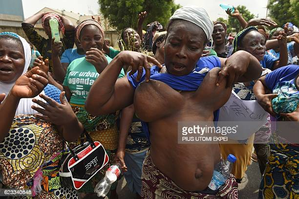 A women raises her breast as residents of Otodo Gbame EbuteIkate and other waterfront communities in Lagos slums mostly ancestral fishing informal...