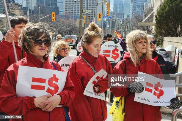 Women rally outside the Ontario Ministry of Labour building to demand equal pay for women and an end to the wage gap between the sexes on 'Equal Pay...