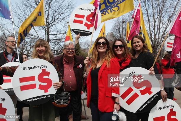 Women rally to demand equal pay for women and an end to the wage gap between the sexes on 'Equal Pay Day' in Toronto Ontario Canada on April 11 2017...