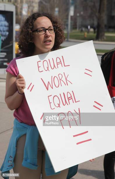 Women rally to demand equal pay for women and an end to the wage gap between the sexes on 'Equal Pay Day' in Toronto, Ontario, Canada, on April 11,...