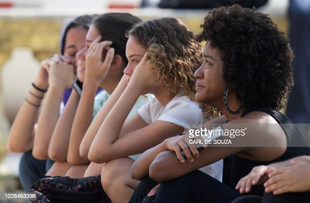 Women react a day after a massive fire ripped through Rio de Janeiro's treasured National Museum one of Brazil's oldest on September 3 2018 The...