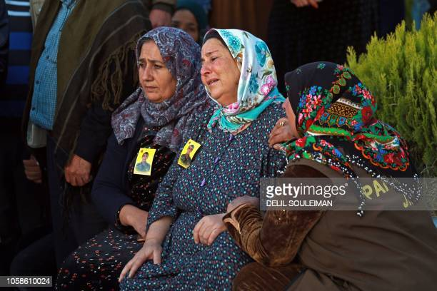 Women react during the funeral of a Syrian Democratic Forces fighter killed in an offensive by the Islamic State movement against an SDF position...