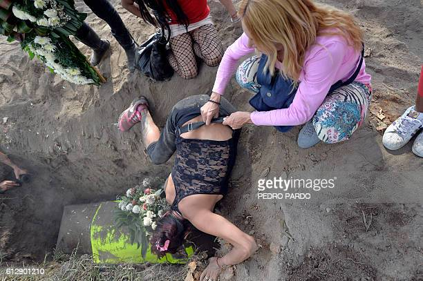 TOPSHOT Women react during the funeral of sex worker Paola Ledezma murdered on September 30 at the Puente de Alvarado street in Mexico City on...