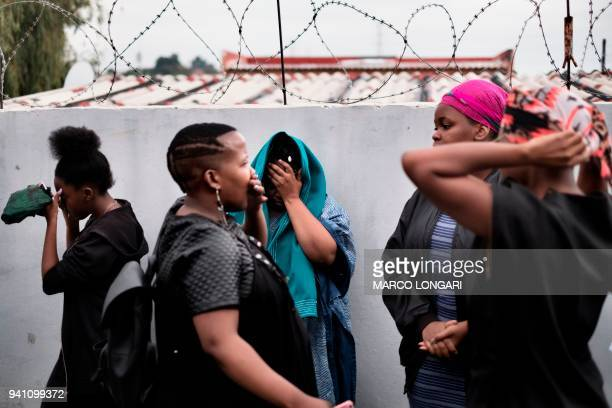 TOPSHOT Women react outside of the house of late South African antiapartheid campaigner Winnie MadikizelaMandela exwife of former South African...