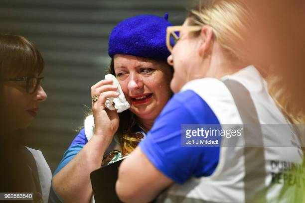A women reacts as the count in the Irish referendum on the 8th amendment concerning the country's abortion laws takes place at the RDS centre on May...