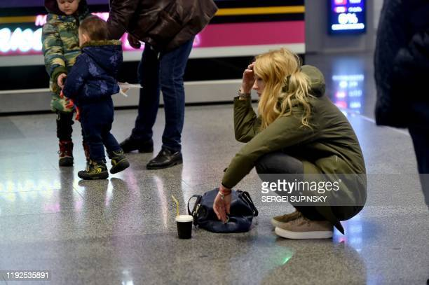 TOPSHOT A women reacts at the arrival gate of the Boryspil airport outside Kiev on January 8 2020 A Ukrainian airliner carrying 176 people from seven...