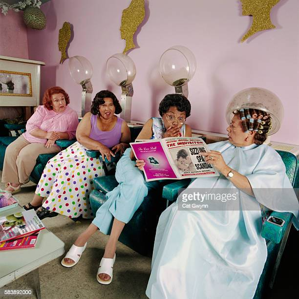 women reading magazine at salon - gossip stock pictures, royalty-free photos & images