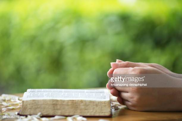Women reading the Holy Bible.