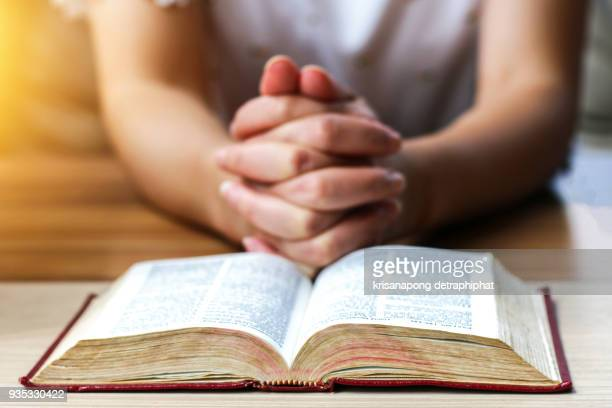 women reading the holy bible., reading a book.,reading - religious role stock photos and pictures