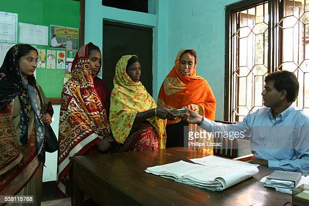Women Receive Grameen Bank Loan