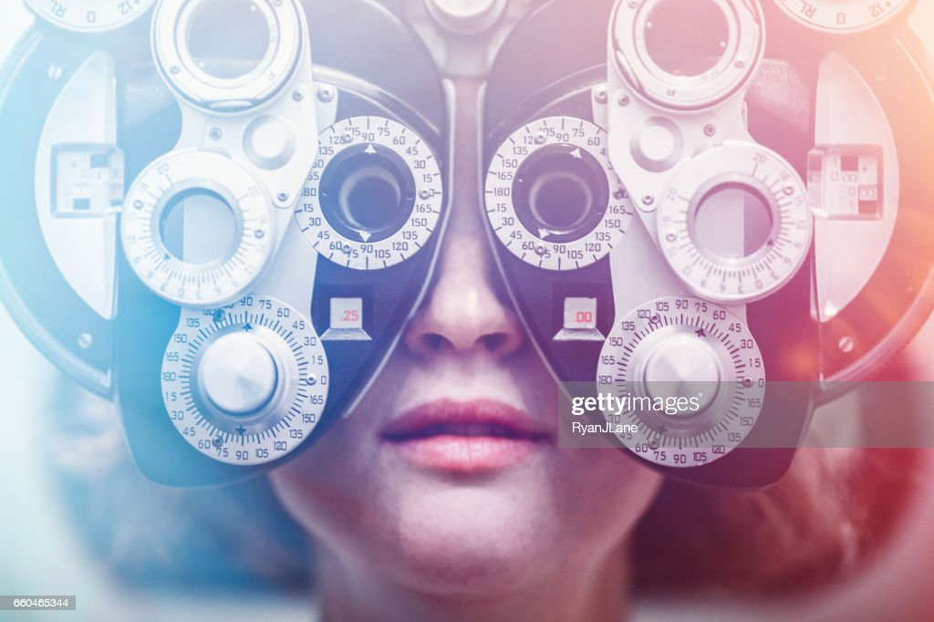 Women Receiving Eye Exam : Stock Photo