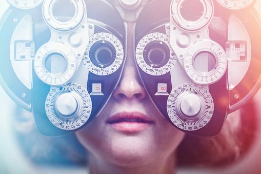 Women Receiving Eye Exam 660465344