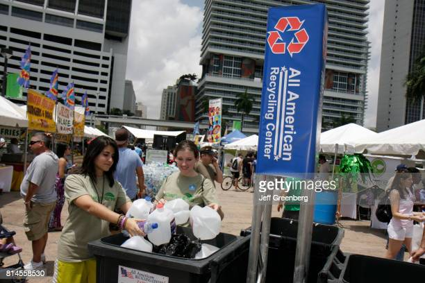 Women recycling plastic water bottles at the Miami Goin' Green event