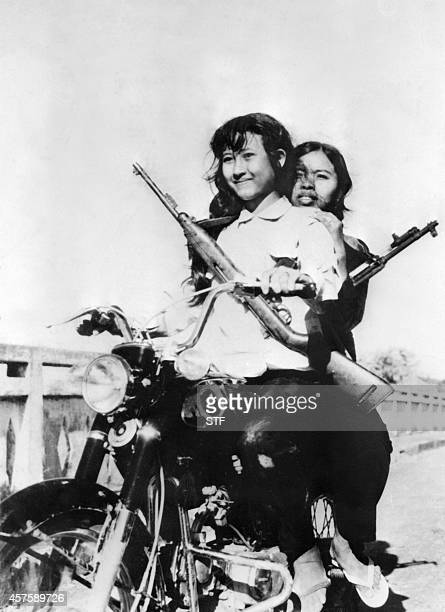 Women Red Khmers ride a Japanese motorcycle in the streets of the Cambodian capital of Phnom Penh in April 1975 On New Year's Day 1975 Communist...