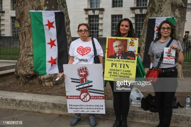 Women refuges from Syria with flags protesting in front of Downing Street house of the British Prime Minister and headquarters of the British...
