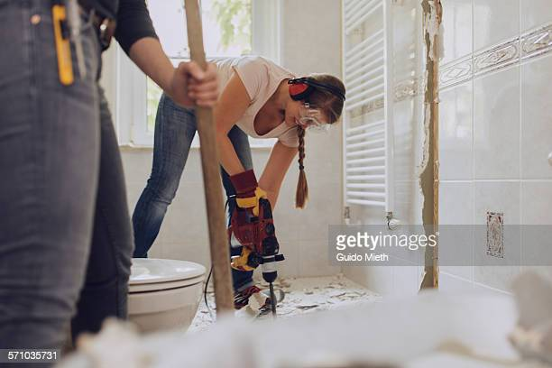 women refurbishing bathroom. - home improvement stock pictures, royalty-free photos & images