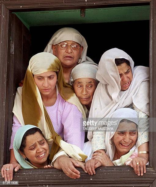 Women relatives of Abdul Rashid mourn his death during the funeral in Srinagar, 19 June 2002. Suspected Islamic rebels early 19 June shot dead the...