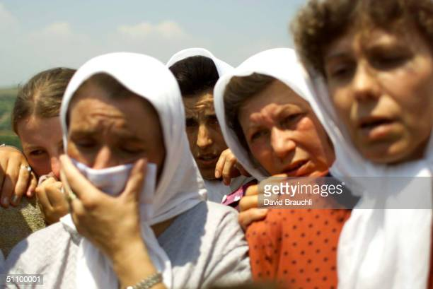 Women Relatives Of Ethnic Albanians Who Were Apparently Slaughtered By Serb Forces During The Nato Bombing Campaign Of Kosovo Mourn Monday July 5...