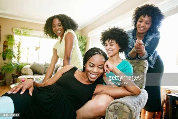 women relaxing in armchair - ナチュラルヘア ストックフォトと画像