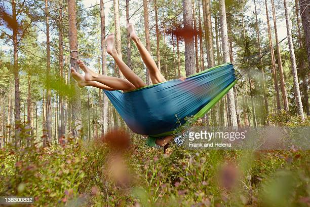 women relaxing in hammock in forest - low angle view stock pictures, royalty-free photos & images