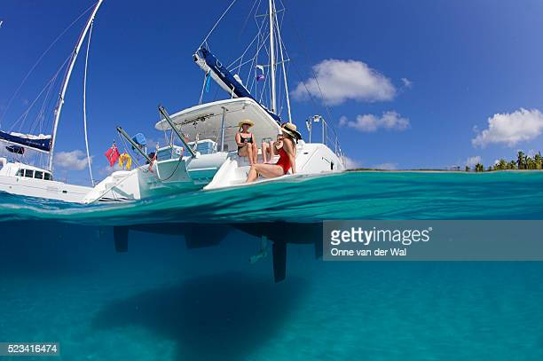 Women Relaxing on Stern of Chartered Catamaran