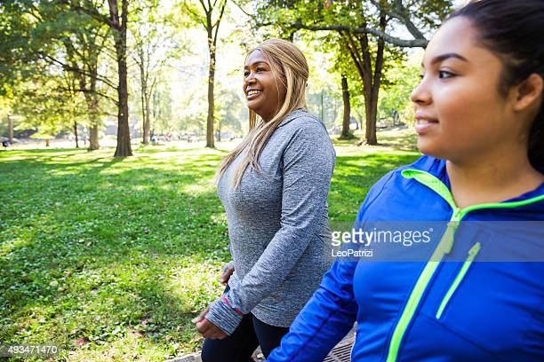 Women relaxing post workout in Central Park New York