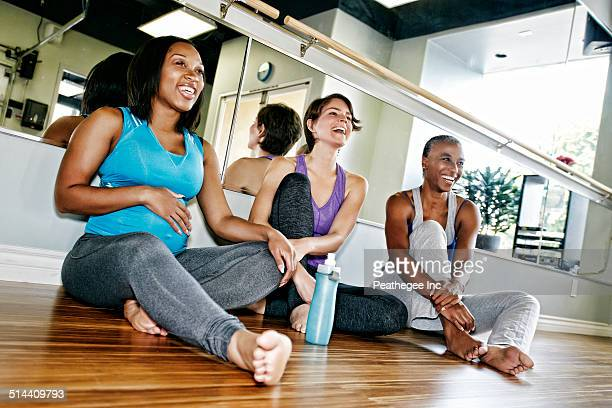 Women relaxing together in yoga studio