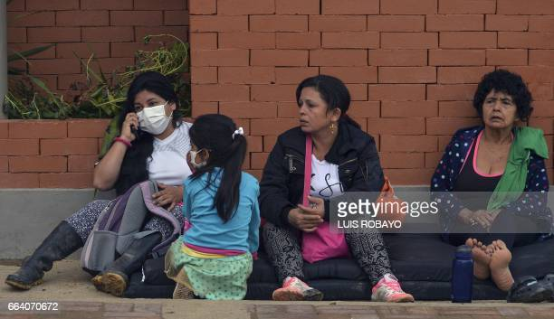 Women remain at a shelter in Mocoa Putumayo department southern Colombia on April 3 2017 Residents of Mocoa were Monday desperately searching for...