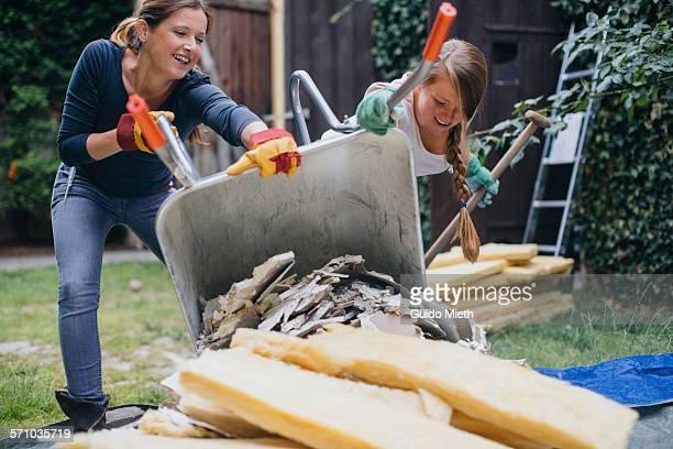 Women renovate home.