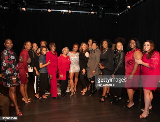 Women representing the Susan B Komer Foundation pose as Vanessa Bell Calloway is appointed the new face of breast cancer at WACO Theater Center...