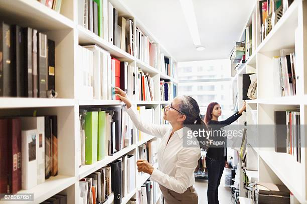 Women researching in design agency library