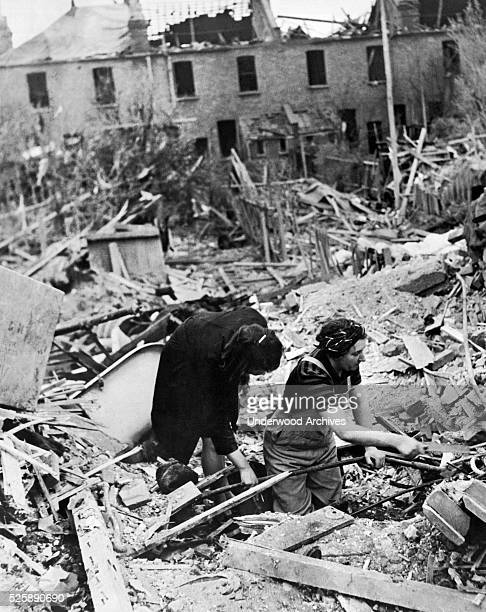 Women residents searching through the ruins of their house after a nighttime bombing by Germany London England circa 1943
